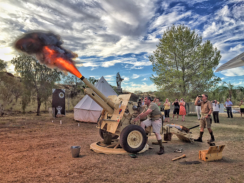 Doug Dreager from the Department of Correctional Services (at rear) commands the firing party at the ANZAC Hill ceremony. Photo courtesy of Damien Ryan, Mayor of Alice Springs