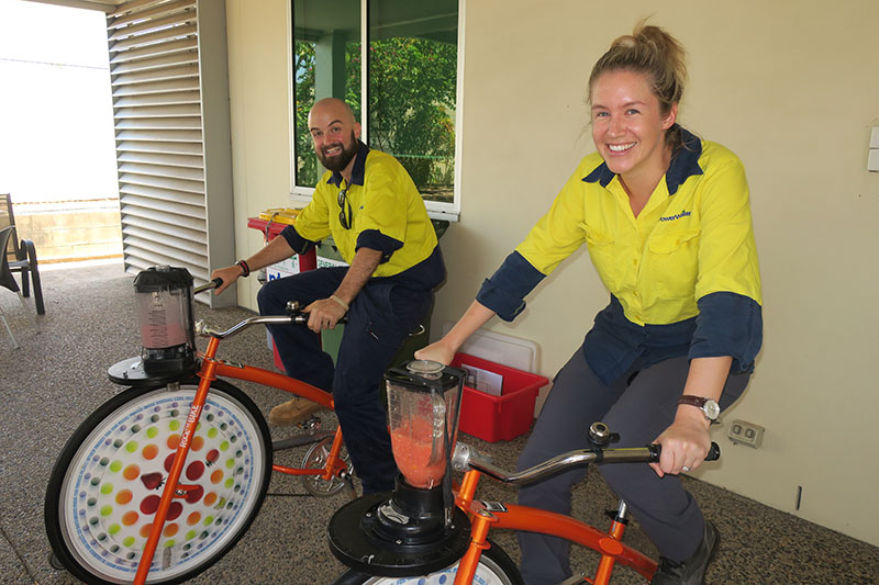 Power and Water employees use special bikes to whiz up a smoothie to hydrate prior to the information session