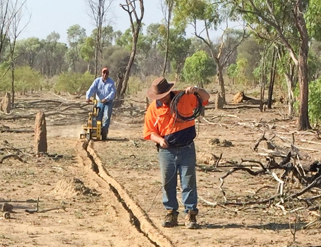 Laying cable at the Northern Territory's first AusLAMP site